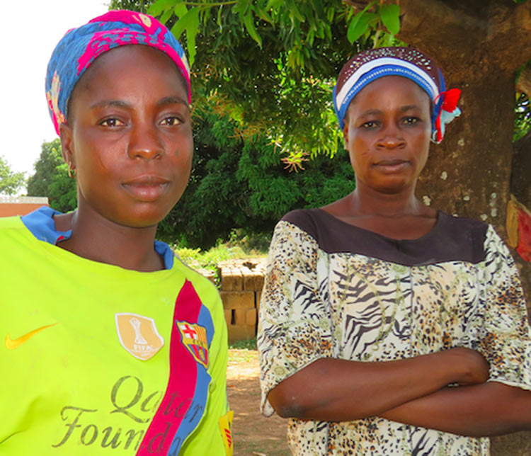 Sakina (left) and community health volunteer Howa Braimah.